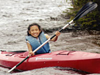 Chona takes a ride in a kayak