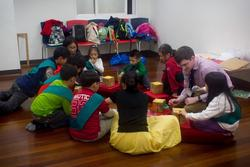 Children making a craft in their small groups during the seminar.